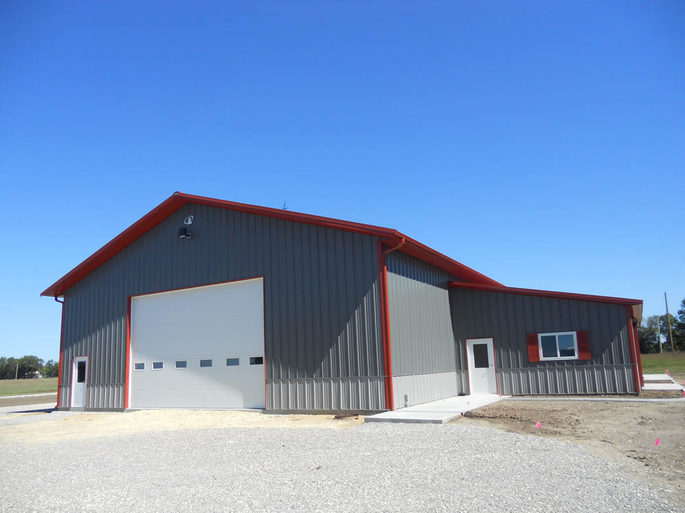 Gray metal building with red trim