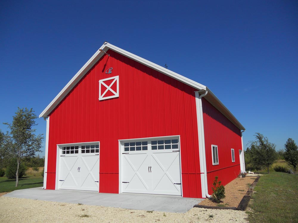 Red metal barn with 2 garage bays