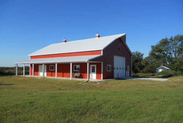 Red metal barn with covered porch